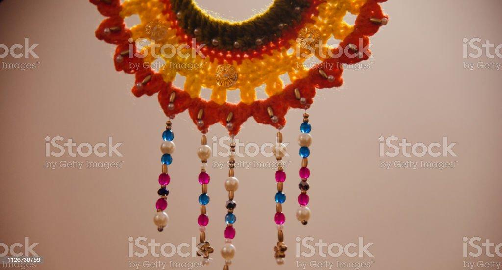 Handmade hanging woollen decorative elements stock photo