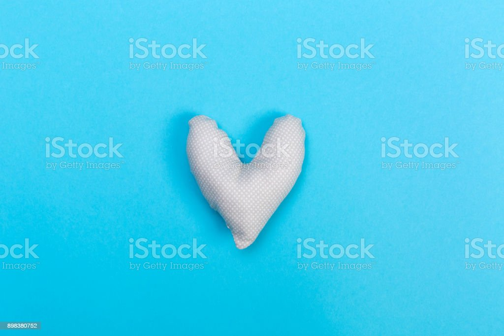 Handmade heart cushions on blue stock photo