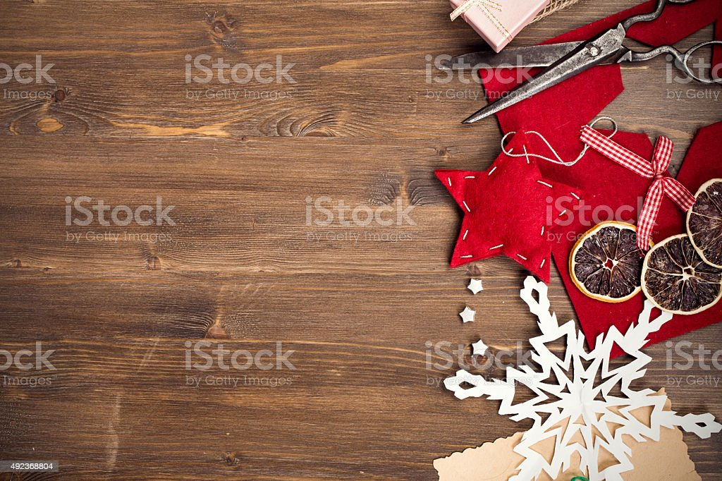 Handmade holiday decorations and vintage scissors at right side stock photo