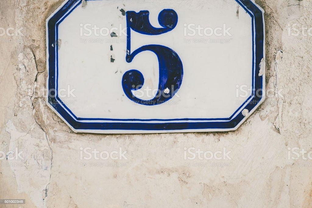 Handmade House Number 5 on Old Italian Wall stock photo