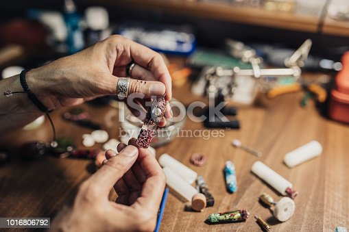 991427116 istock photo Handmade jewelry in making 1016806792