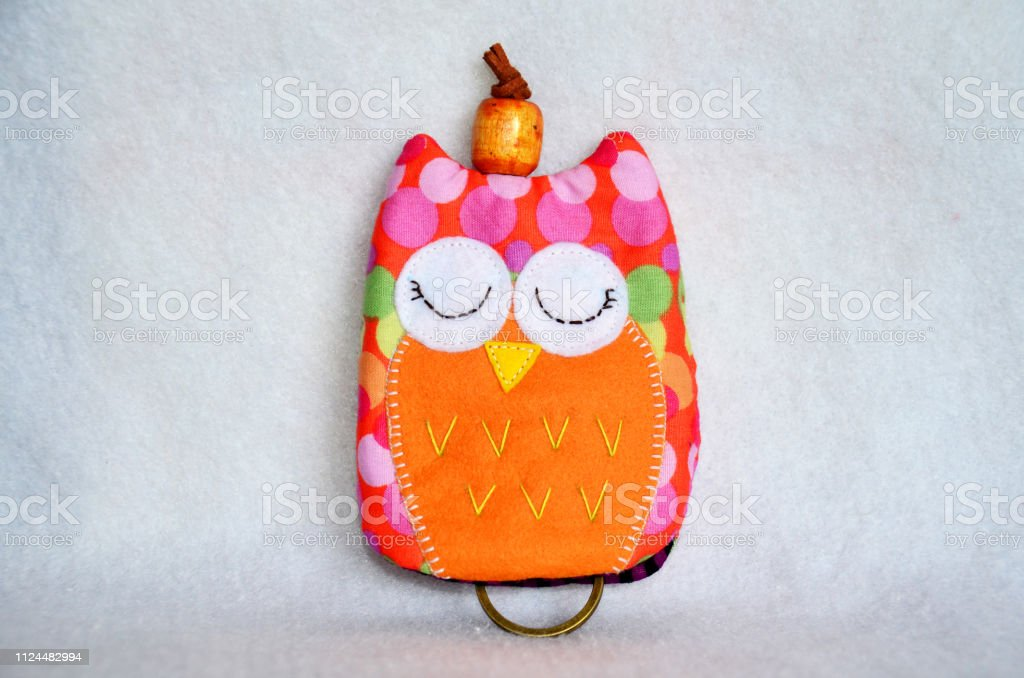 DIY handmade key cover owl doll pattern made from colorful fabric and leather and plastic beads in workshop thai style stock photo