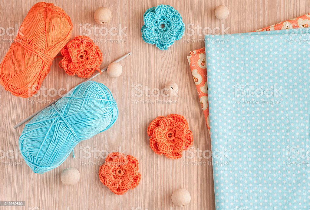 Handmade knitted crochet flowers and wooden beads. Cotton yarn stock photo