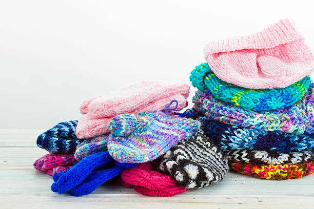 Handmade Knitted Mittens, Hats and Slippers stock photo