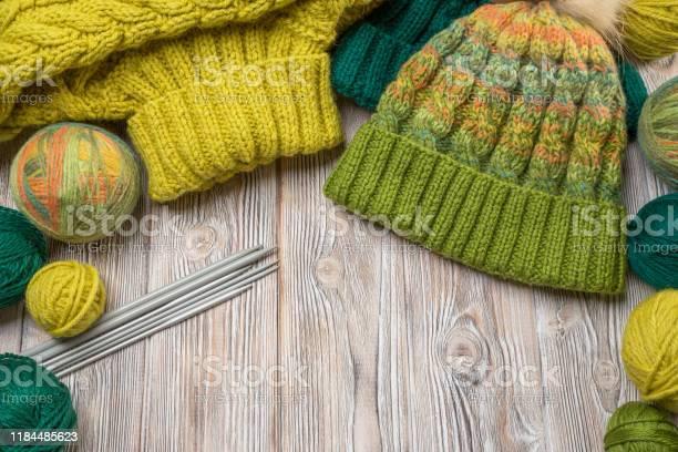 Handmade knitwear with balls of thread and knitting needles on a as picture id1184485623?b=1&k=6&m=1184485623&s=612x612&h=uj1yu 0ounntxshzgxbtk0ytcgt6qvnsd6bsuttx85g=