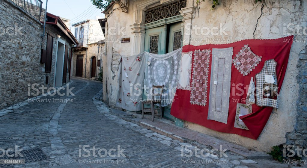 Handmade laces on the wall. stock photo