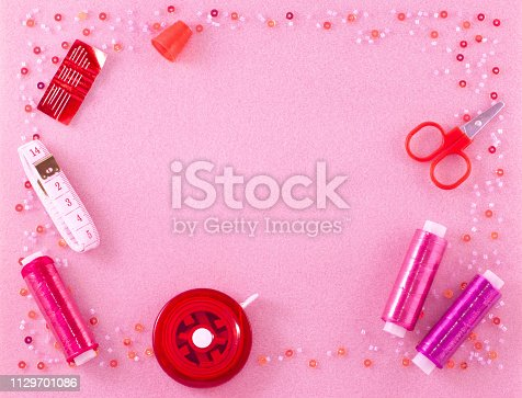 istock Handmade materials on a pink background. 1129701086