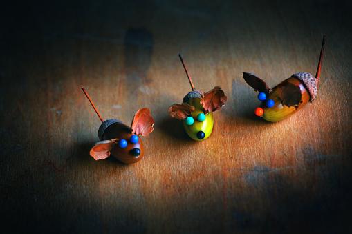 istock Handmade mouse acorn table 1037007546