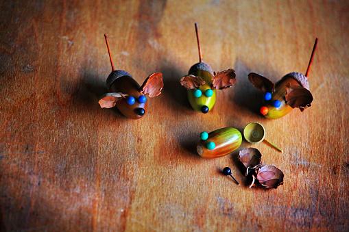 istock Handmade mouse acorn table 1037007938