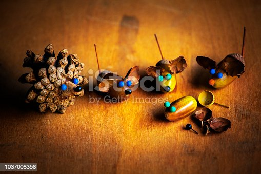 istock Handmade mouse acorn table 1037008356