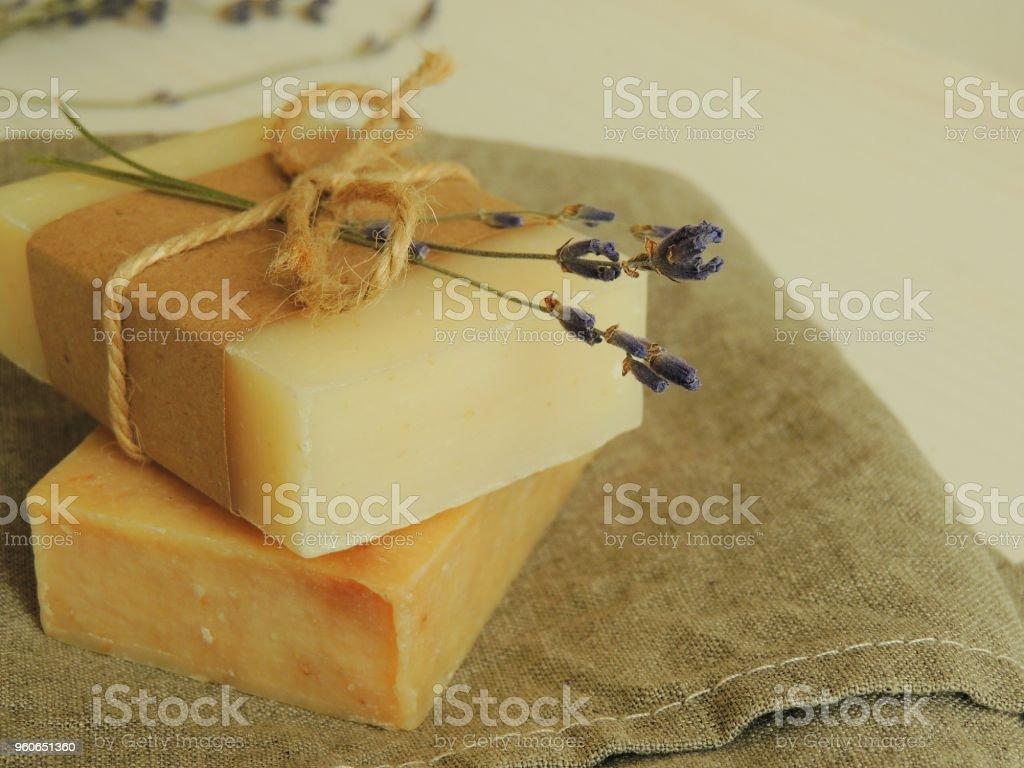 Handmade natural spa bath soap on linen towel. stock photo