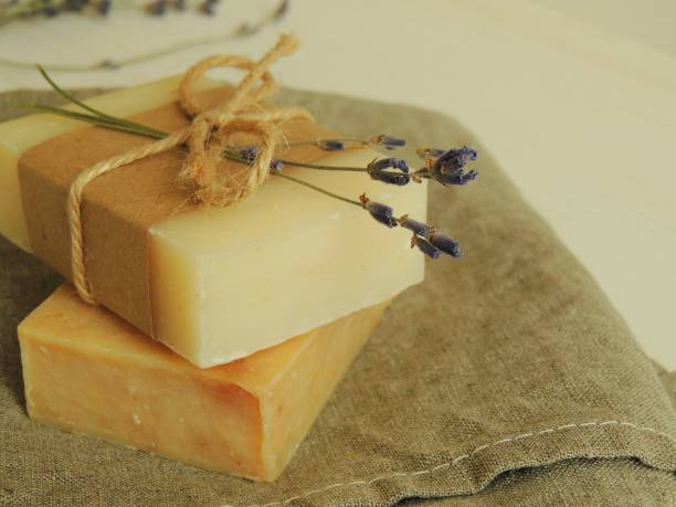 Handmade natural spa bath soap on linen towel. stock photo
