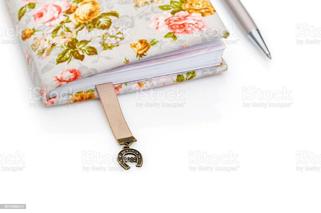 Handmade notebook fragment with horseshoe bookmark stock photo