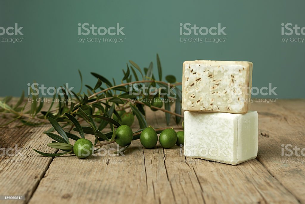 Handmade olive soap on wooden table. stock photo