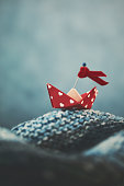 Handmade origami love boat on handmade waves - props made by photographer