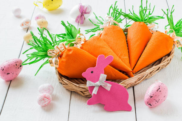 Handmade package for Easter sweet gift in form of carrots stock photo