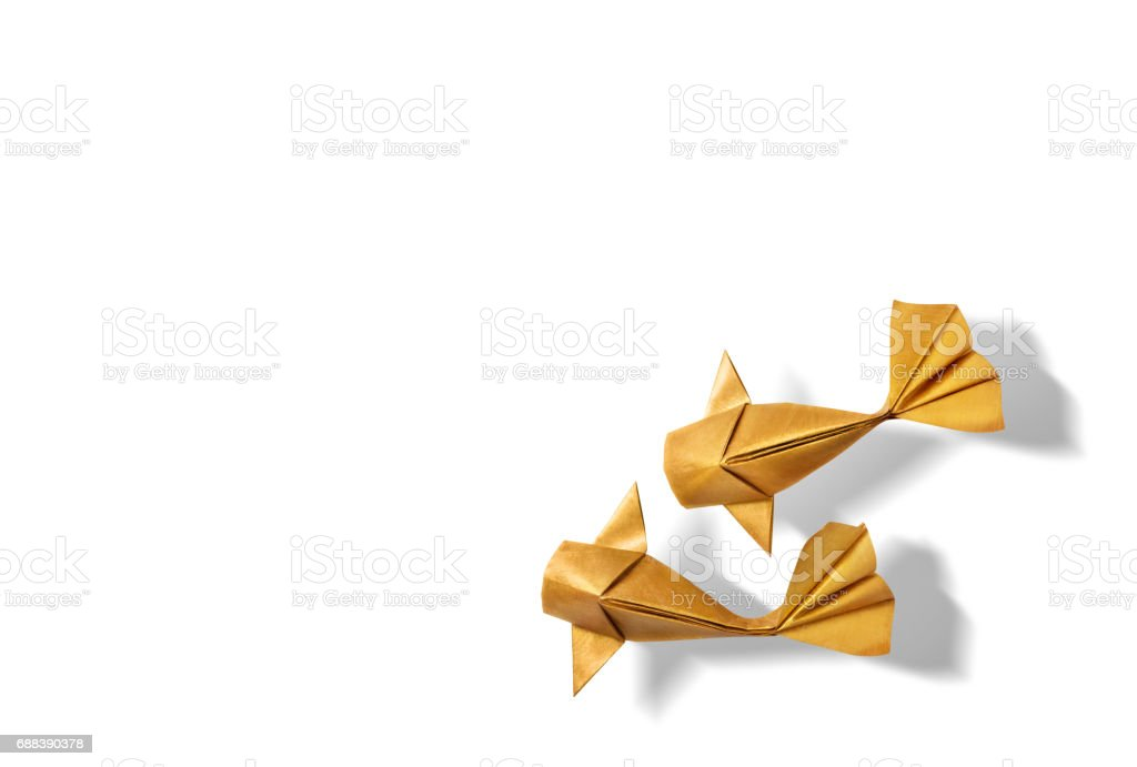 Handmade paper craft gold color origami koi carp fish. stock photo