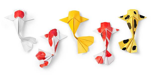 handmade paper craft origami koi carp fish on white background stock photo