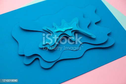 istock Handmade paper cutting waves on blue colors. 1210019390