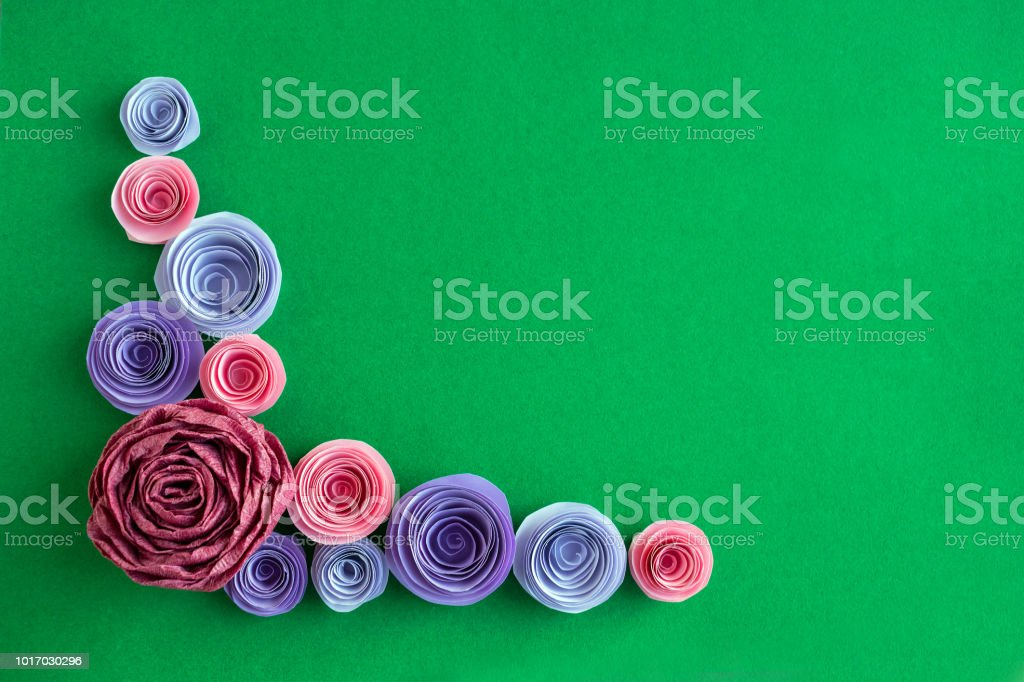 Handmade Paper Flowers Angled Frame On A Green Background Beautiful
