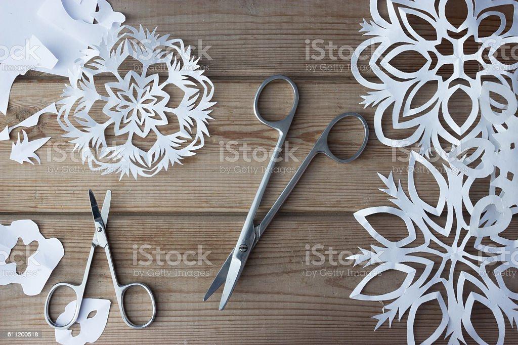 handmade paper snowflakes and scissors stock photo