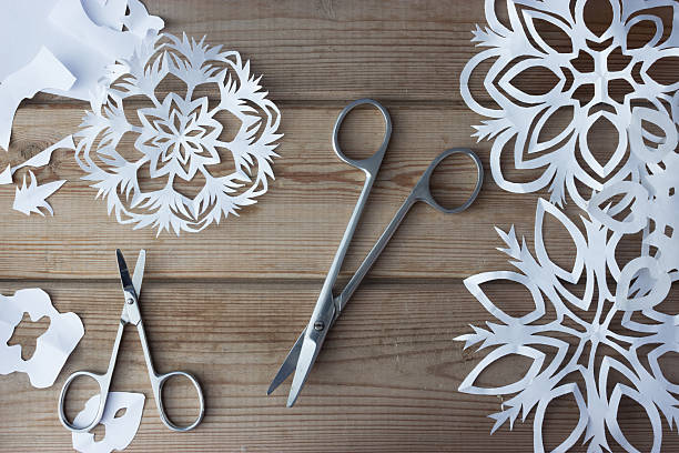 handmade paper snowflakes and scissors - origami dekoration stock-fotos und bilder