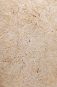 istock Handmade paper texture with vegetable fibers like straw. In delicate tones, yellows, oranges, browns and vanilla. 1015260446