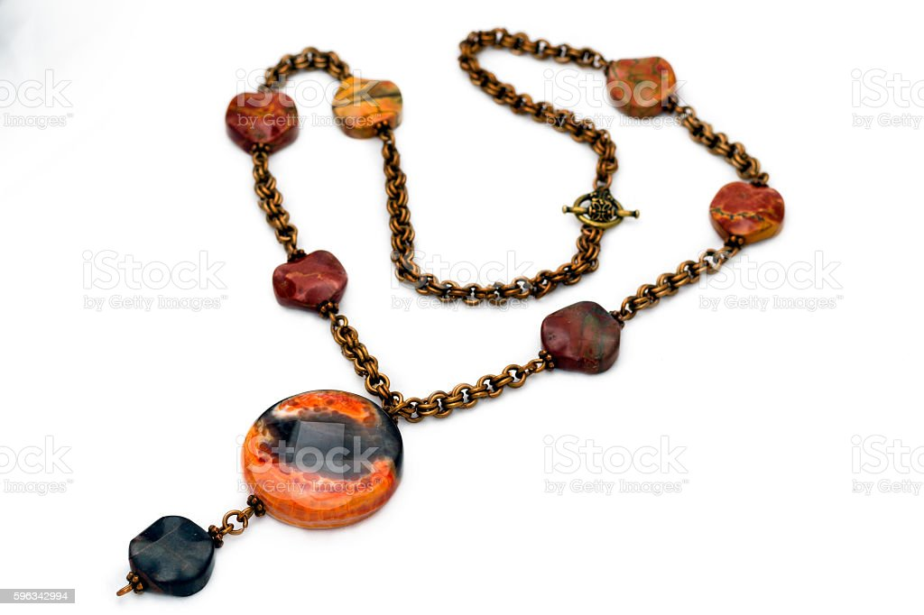 Handmade pendalt with copper chain isolated on white royalty-free stock photo
