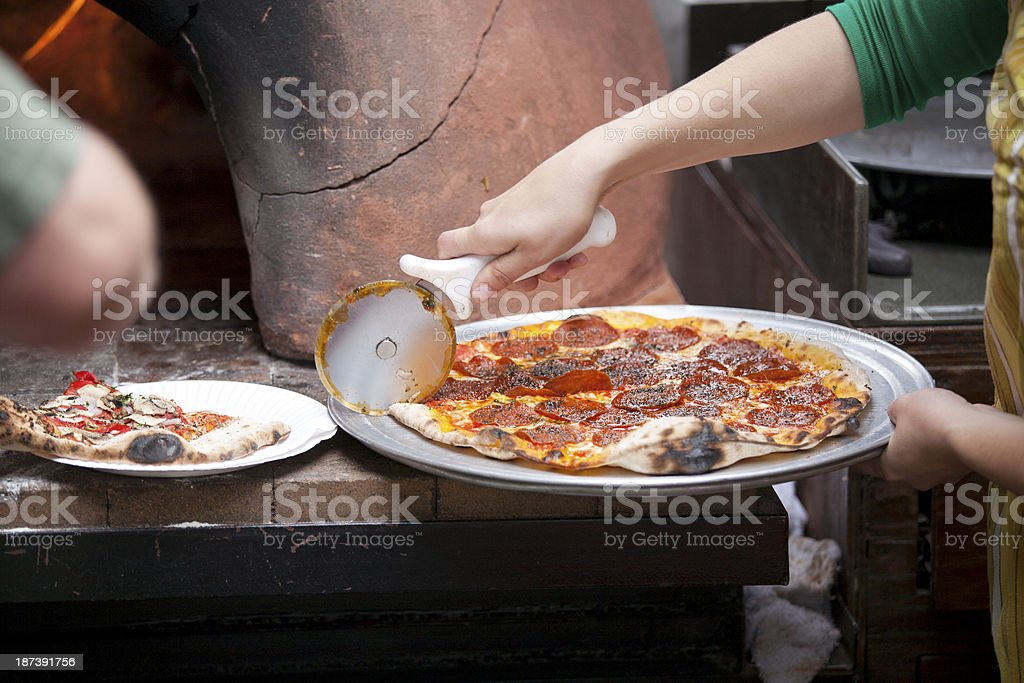 Handmade Pizza and wood burning oven royalty-free stock photo