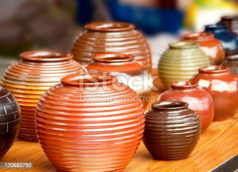 Glazed ceramics are for sale at an outdoor market