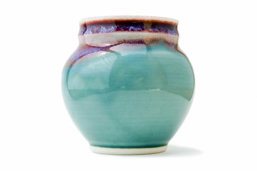 Handmade pottery vase on white