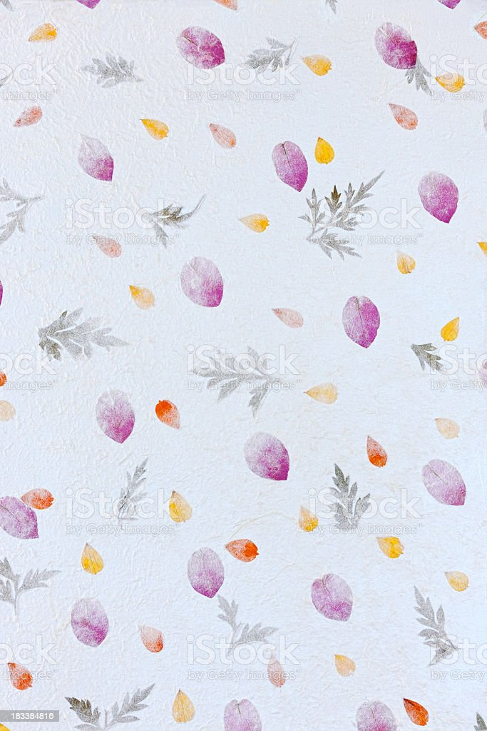 Handmade recycled flower and leaf paper background. royalty-free stock photo