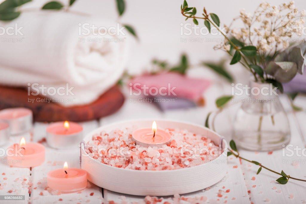 Handmade Salt Peach Scrub With Argan Oil. Himalayan Salt. Toiletries, Spa Set with candles and white towel stock photo