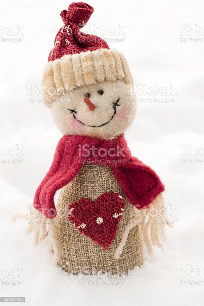 Handmade santa christmas decoration on real snow background royalty-free stock photo