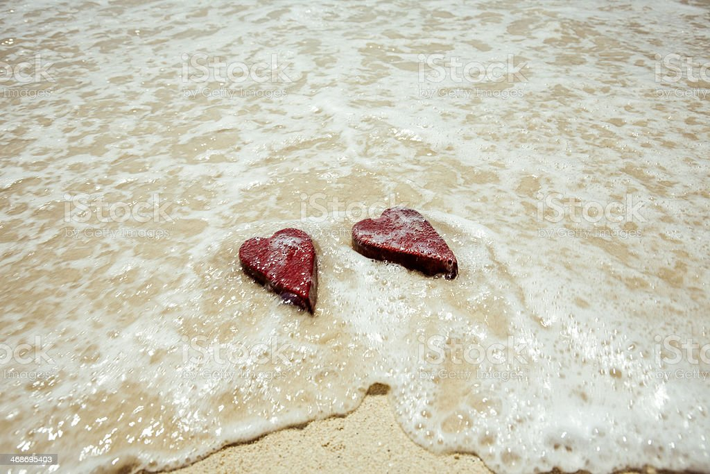Handmade shabby Red heart sand background royalty-free stock photo