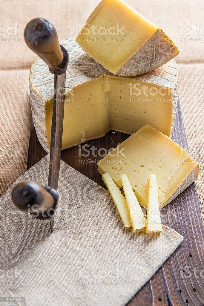 Handmade sheep cheese on the cutting board royalty-free stock photo