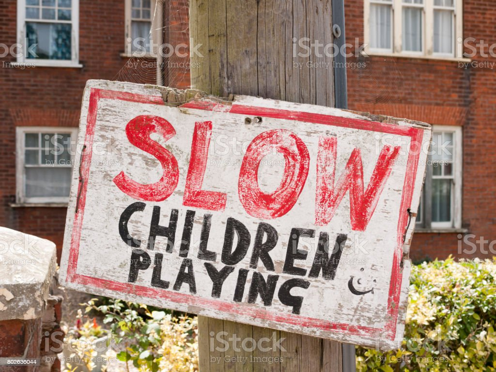 handmade sign for slowing down near children transport stock photo