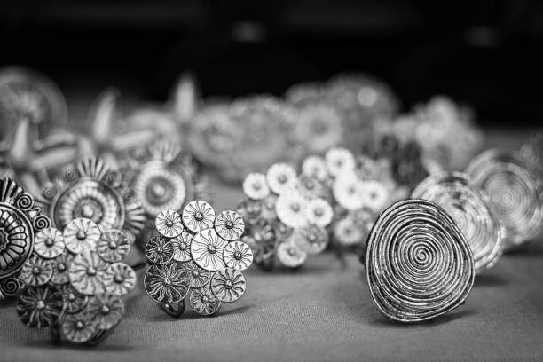 Handmade silver brooches stand on street market stock photo