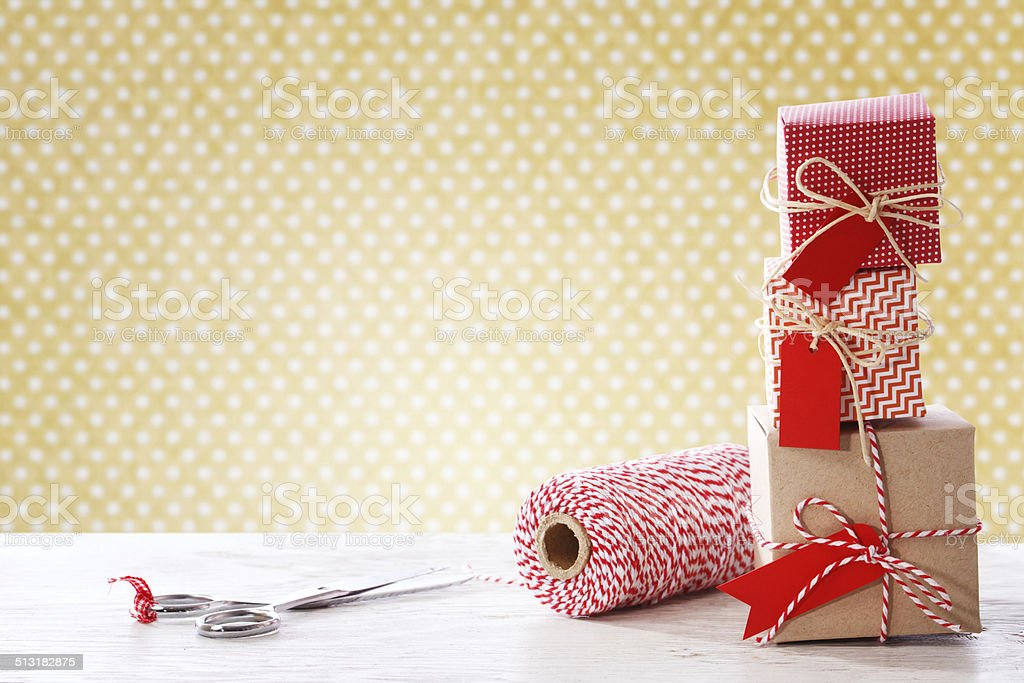 Handmade small boxes with scissors and spool stock photo