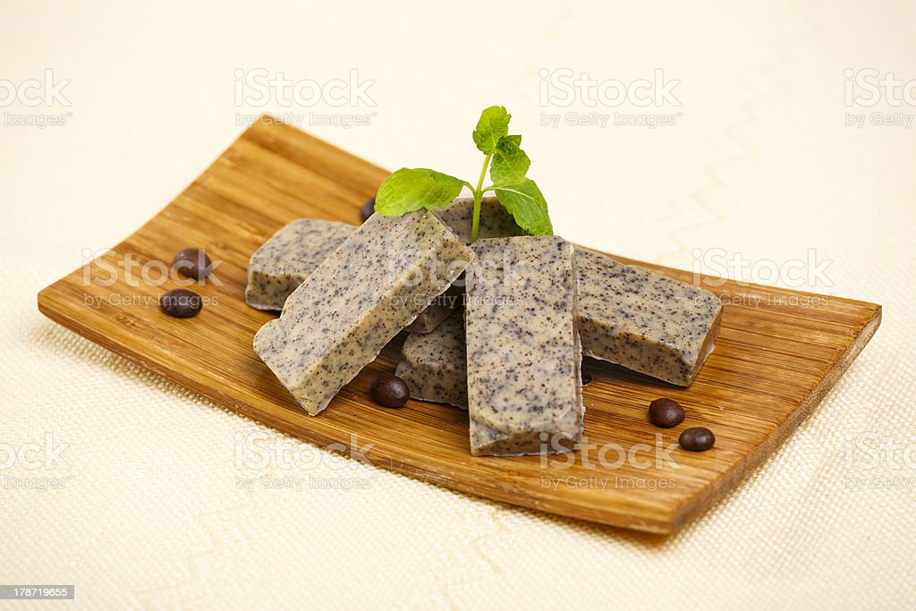 Handmade soap bars on wooden stand royalty-free stock photo