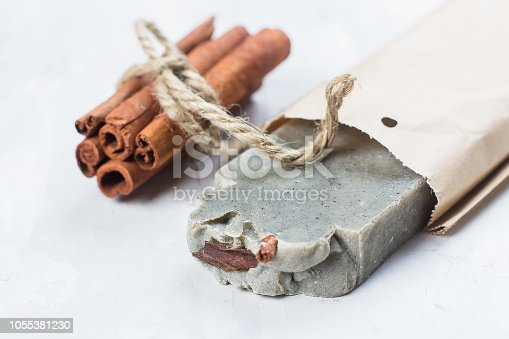 istock Handmade soap with cinnamon on white background 1055381230
