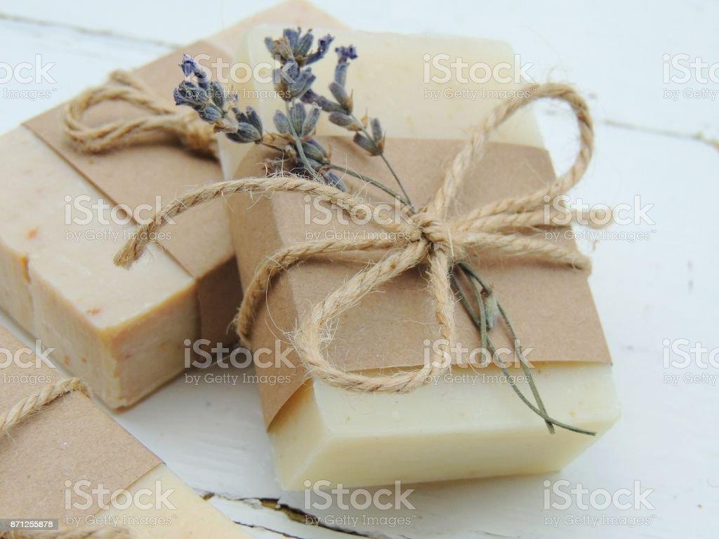 Handmade spa bath soap on vintage wooden background.