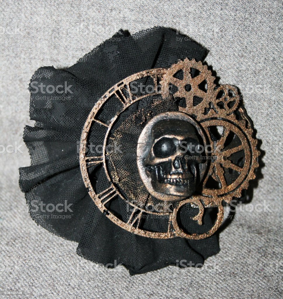 Handmade steampunk brooch with a skull, bronze decorative elements and black lace stock photo