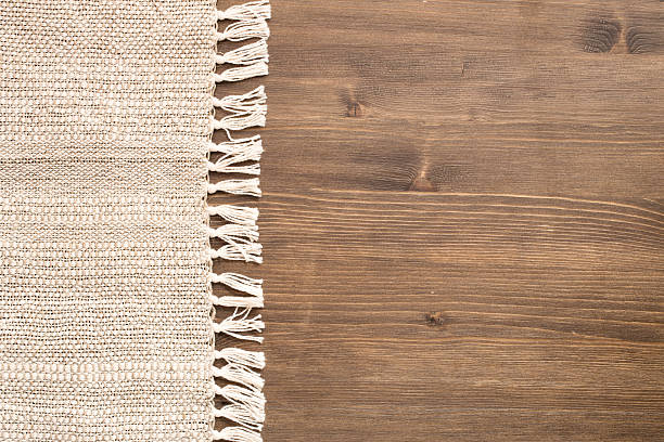 Cтоковое фото Вручную Скатерть на левой стороне деревянном фоне