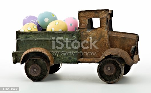 istock Hand-Made Toy Truck Delivering Bright Multicolored Easter Eggs 116568468