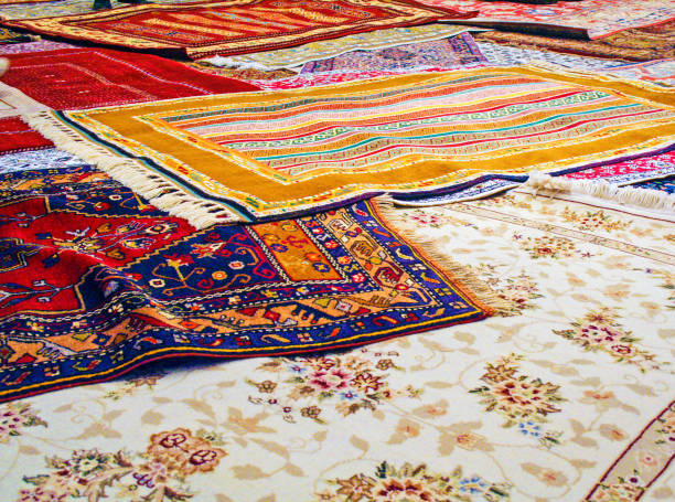 handmade traditional carpets handmade traditional carpets in a textile manifacturing in Turkey persian culture stock pictures, royalty-free photos & images