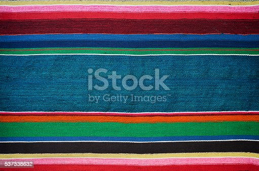 istock Handmade traditional old ukrainian colorful striped carpet rug texture 537338632