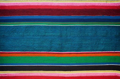 istock Handmade traditional old ukrainian colorful striped carpet rug texture 537338632