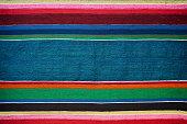 Handmade traditional old ukrainian colorful striped carpet rug texture