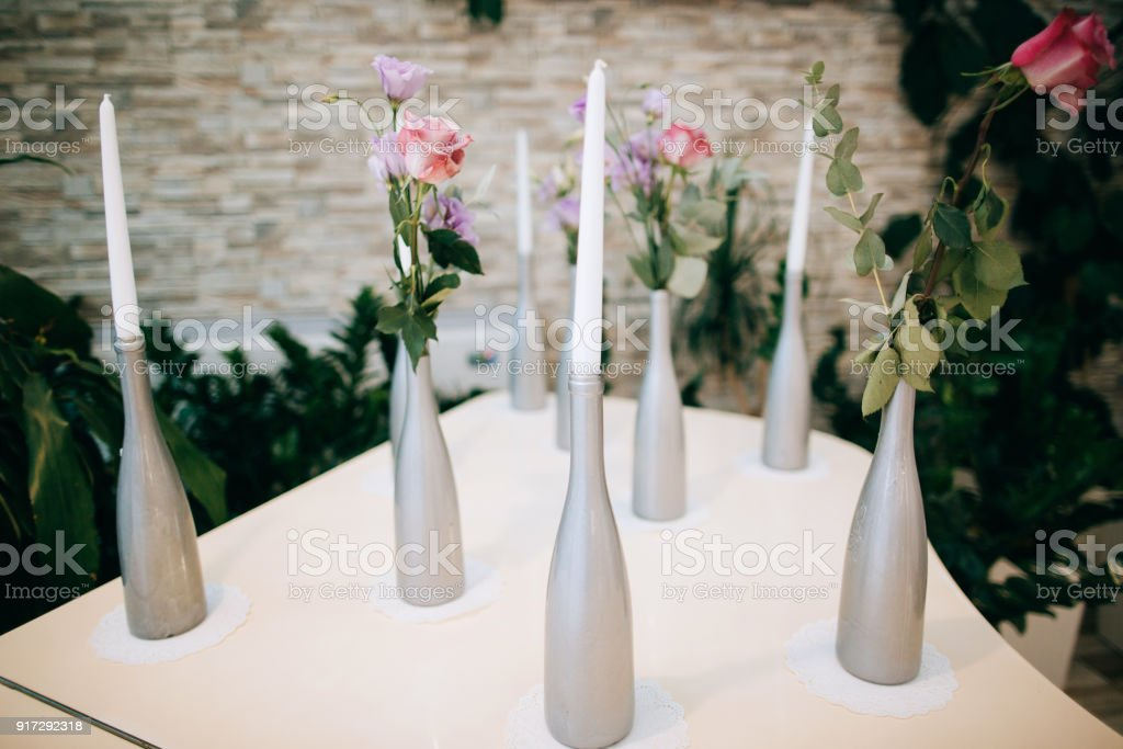 Handmade Wedding Decoration Candles And Vases With Old Bottles Stock
